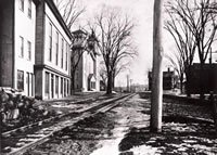 Main Street, Bethel c. 1900 .....This photo shows Main St. with the tracks of the old Shepaug Railroad connecting line running along its north side. This railroad line, which could take passengers from the Bethel Station at Deport place to the main line of the Shepaug at Hawleyville, Newtown, began service on July 4, 1872, and was actually owned by the Danbury and Norwalk Railroad, although most Bethelites referred to it as the Shepaug line. The line was abandoned, except for a service spur serving some Bethel businesses, in July of 1911. The building, now occupied by the Bethel Historical Society and the V.F.W as well as the Congregational Church can be seen at the left.