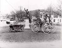 """Old Forgotten"" ....Shown on P.T. Barnum Square, around the Doughboy, is  ""Old Forgotten"" Bethel's first piece of fire apparatus. This hand-drawn pumper can be found in the South St Fire Dept. Museum.  Also shown is a hand-drawn hose wheel."