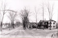 The Corner of Greenwood Ave. & Blackman Ave c. 1910                                                                          Bethel's main thoroughfare in the first years of the 20th century.  Notice the dirt streets with the cobblestone path running between the trolley tracks. In the distance can be seen the hand-cranked railroad gates. The numerous Elm trees that lined both sides of the street eventually fell victim to the Dutch-elm disease that swept throughout a portion of New England in the 1960s.