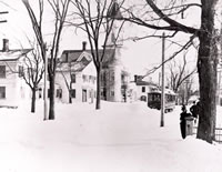 Blizzard on Center Street c.1900                                                                                                                                                  Greenwood Avenue, (then known as Center St,) following a winter storm. The trolley shown, began service on January 1, 1895, and ceased running in November of 1924. The spire of the Methodist Church as well as the Methodist parsonage can be seen on the left side of the street. The building to the left of the parsonage has since been obscured by the storefront currently occupied by H & R Block and The Toy Room.